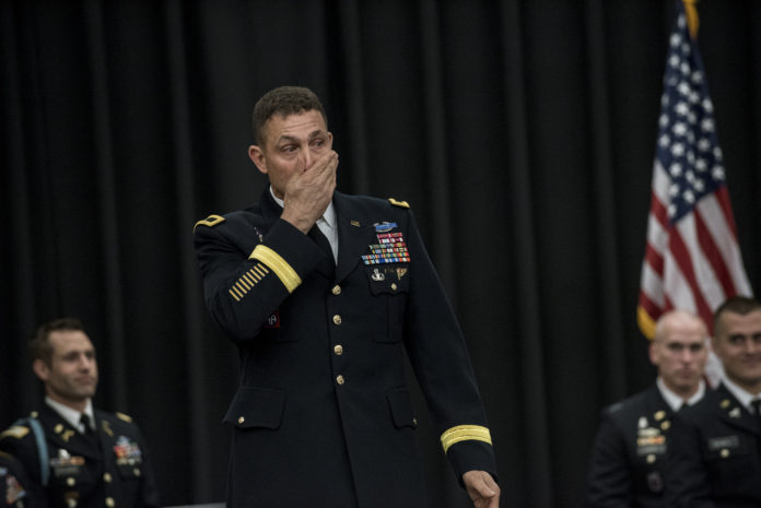 Brig. Gen. Brian J. Mennes composes himself as he begins his keynote speech to graduating cadets, family members and friends at the Army ROTC's Spring 2017 commissioning ceremony. Mennes said as he sat on the airplane to travel to Louisville, several people thanked him for his service, and he felt humbled.