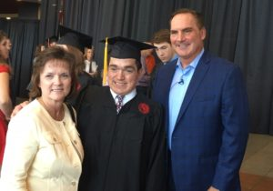 Jeanne and Mark Dant pose with son Ryan Dant at UofL's May 13 commencement.