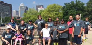 Todd Crawford, Center, with participants in the 5K to Cure Paralysis in 2015